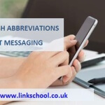 English Abbreviations in Text Messaging, hand tapping on a smartphone