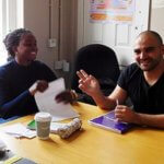 Students smiling. Afternoon English speaking class in London study centre for adults