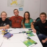 4 students of English in the class learning on intermediate evening English course for adults