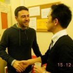 Two students shaking hands and speaking English in our language school in London