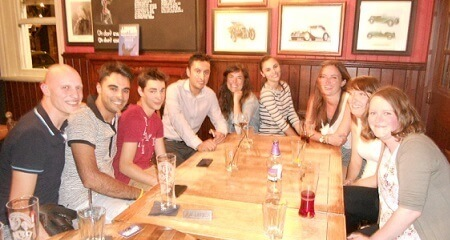 Students sitting in a pub in Ealing talking English in the evening