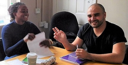 Two international students smiling in English language class intensive in London