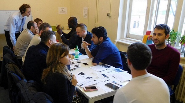 A group of students Adult English school London practising English conversation in class