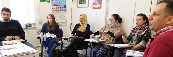 6 students of IELTS preparation course London training and practising for the IELTS exam