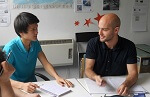 English Conversation Classes in London. Students speaking in English in the class room.