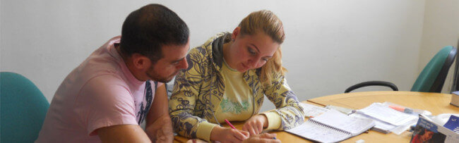 English Courses in London for adults to improve English. Students in the class room.