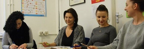 Students of FCE preparation courses in west London learning English in a weekend FCE class