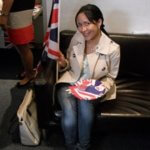 English language course student holding British flag. Learn British English in London English language school for adults