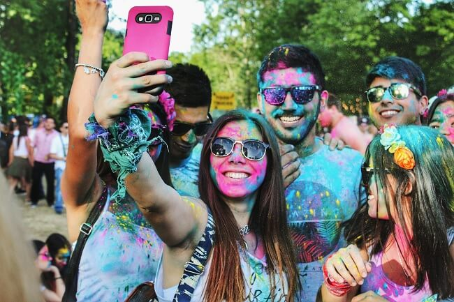 Group of young people taking a selfie in west London festival