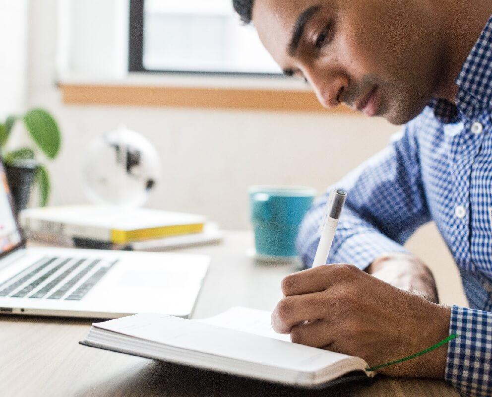 Student writing during weekend IELTS workshop