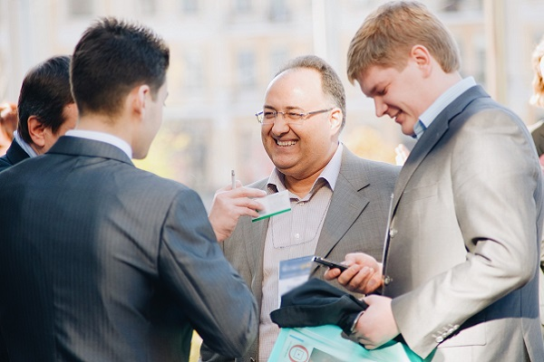 Four Business men networking and communicating in English