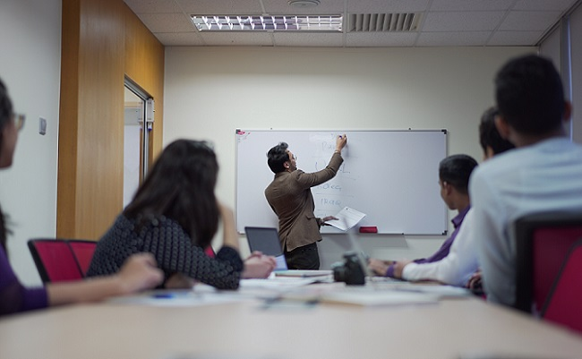 Students and teacher in a class of Evening English language courses in London