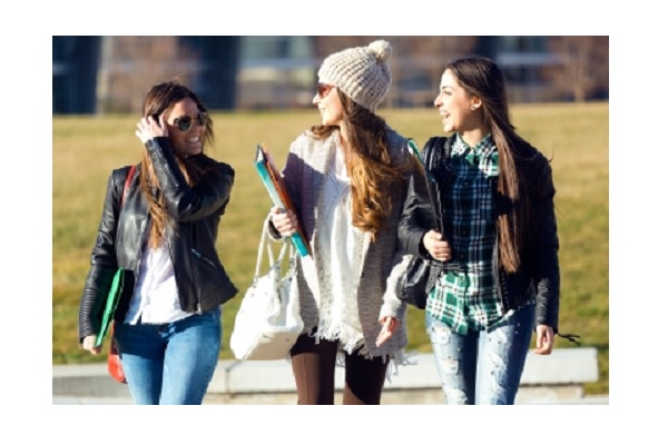 Three students walking, talking and Learning English after school